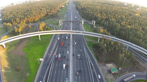 Flying over motorway in city outskirts Footage