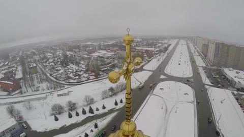 Golden cross on the church in city, aerial view Footage