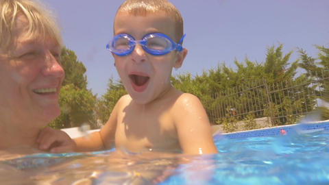 Little Boy and His Family in Home Pool Footage