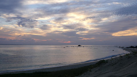 Amami Oshima, Japan - June 17, 2019: Sunrise at Tomori Beach in Amami Oshima, Japan Live Action