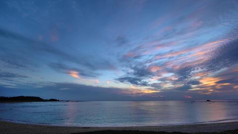 Amami Oshima, Japan - June 17, 2019: (30x times) Sunrise at Tomori Beach in Amami Oshima, Japan Live Action