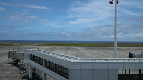 Amami Oshima, Japan - June 20, 2019: Kikai Island viewed from Amami airport observation deck in Footage
