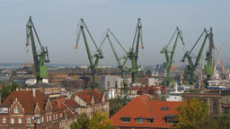 View of Gdansk city with the working shipyard cranes, Poland Footage