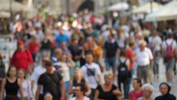 Crowd of people on the street. Defocused. Slow Motion Footage