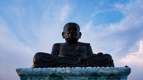 Time-lapse of Luang Pu Thuat Statue, The legendary monk statue above with sky Footage