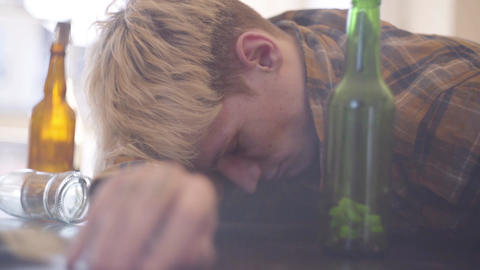 Young man with drug and alcohol intoxication. Troubled teens. Drug addiction Live Action