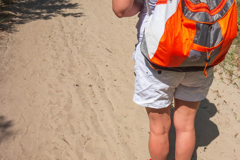 Closeup of woman with backpack. Concept of active lifestyle, hiking and tourism Fotografía