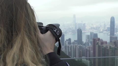 Traveling woman photographing Hong Kong city panorama while travel vacation Live Action