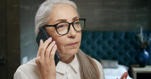 Elderly Woman Talking on Smartphone Live Action