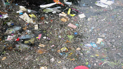 Sea water pollution. Environmental pollution. Garbage on the sea. Rippling garbage accumulated over Live Action