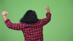 Rear view of hipster man cheering with fists raised Footage