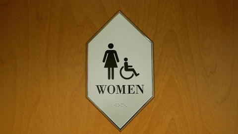 Motion of disable and woman washroom logo on wall with 4k resolution Live Action