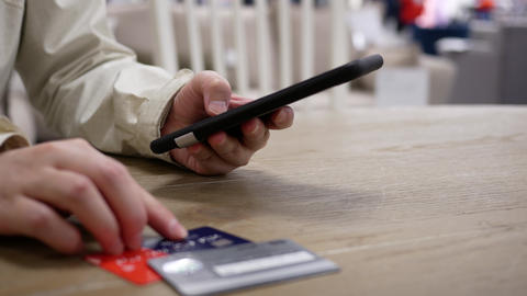 Motion of woman typing credit card number for buying gift on smart phone with 4k resolution Live Action