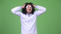 Crazy scientist wearing protective glasses and panicking Footage