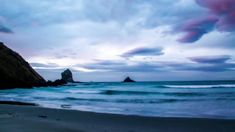 Sea in New Zealand. Gloomy weather. On a gray sky, large, white clouds float Live Action