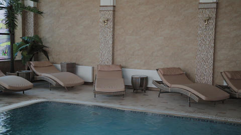 Stylish loungers by the indoor pool Live Action