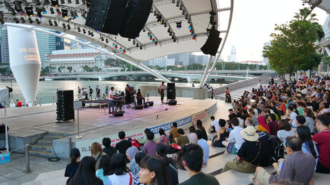 People on the free concert at Marina Promenade in Singapore Live Action