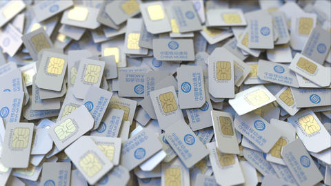 Pile of SIM cards with China Mobile logo, close-up. Editorial telecommunication ビデオ
