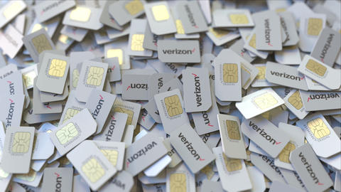 Pile of SIM cards with Verizon Communications Inc. plc logo, close-up. Editorial ビデオ