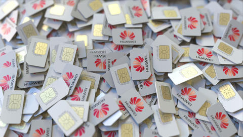 Pile of SIM cards with Huawei logo, close-up. Editorial telecommunication ビデオ