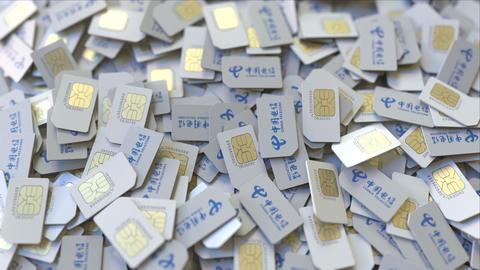 SIM cards with China Telecom logo, close-up. Editorial telecommunication related ビデオ