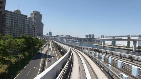 Japanese railway car window. High rise apartment and canal Acción en vivo