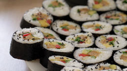 Slider shot through a plate with sushi rolls Footage