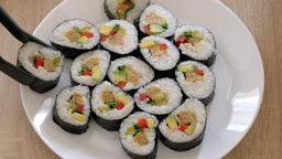 Serving vegan sushi on a white plate Footage