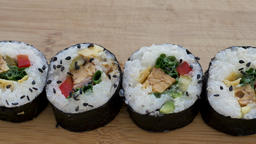 Top view of sushi rolls on a wooden board Footage