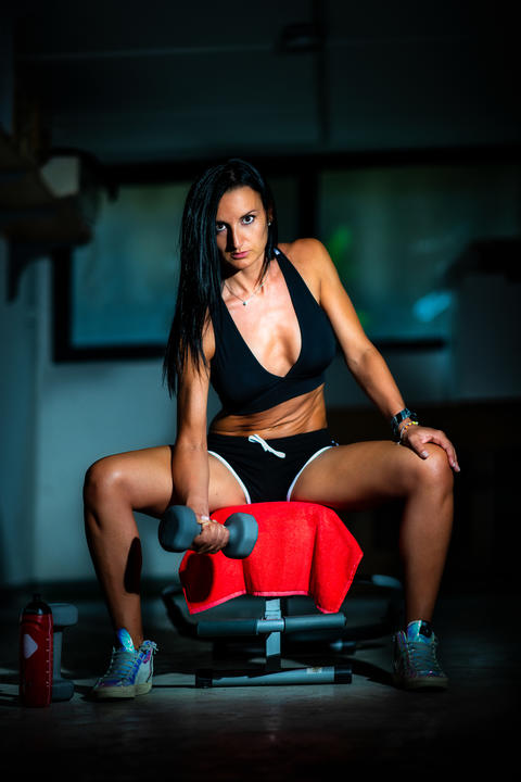 Beautiful girl practicing fitness gym in home garage Photo