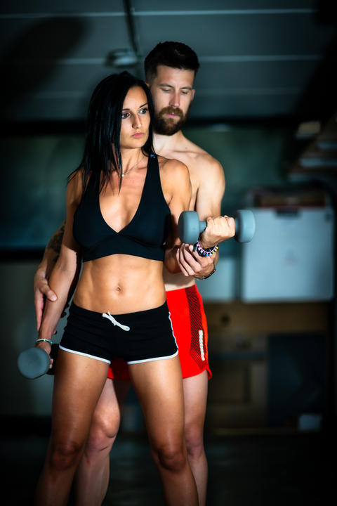 Young sporty woman with her personal trainer Photo