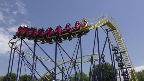 Roller coaster in amusement park Footage