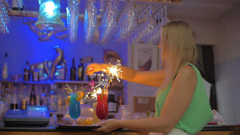 Waitress in the Bar Lighting Bengal Fires in Cocktail Glasses Footage