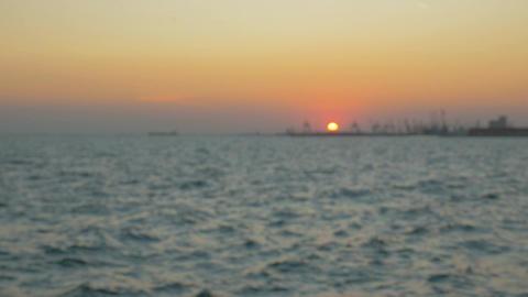 Sunset over the Sea Defocused Footage