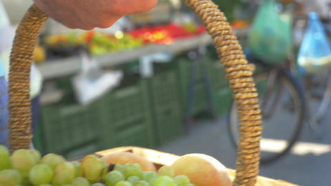 Ripe Green Grapes and Peaches in Wicker Basket Footage