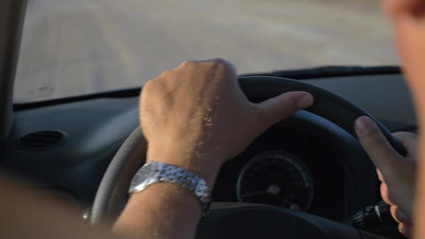 Hands of Man Driving a Car Footage