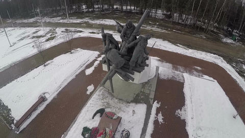 Flying over war monument by the highway