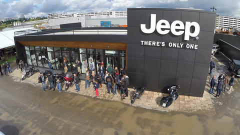 Flying over the people at Jeep dealership Live Action
