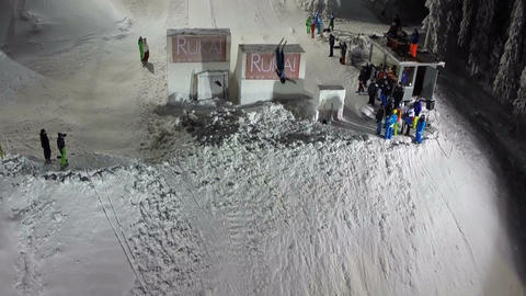 Skier doing trick during jump from the hill, aerial view Footage