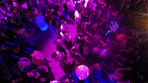 People on New Year party in the club, aerial view