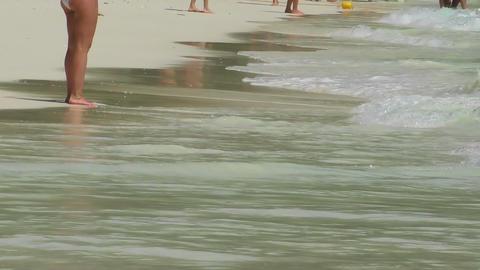 Tourists walk on the beach Stock Video Footage