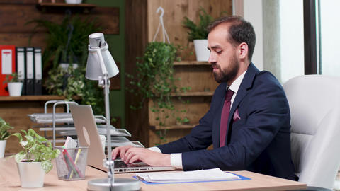 Confident corporate manager typing an email on the laptop Footage