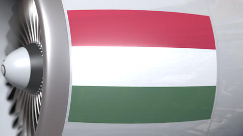Airplane engine with flag of Hungary. Hungarian air transportation conceptual 3D Live Action