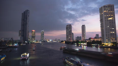 Time lapse, Cityscape view of Chao Phraya River at dusk until night Live Action