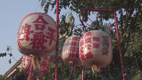 Lanterns with chinese character on it in front of chinese temple. move pass Footage