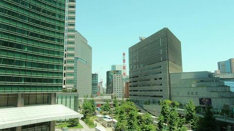 Japan city scenery. Building train lined train car window Acción en vivo