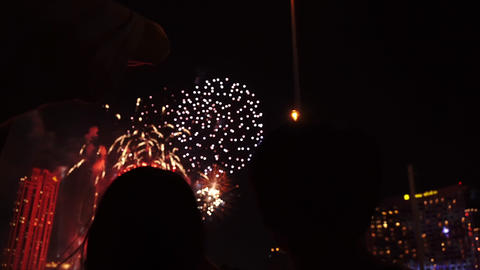 Unrecognized silhouette of love couple celebrating on big event at Bangkok. 4th july. new year. Footage