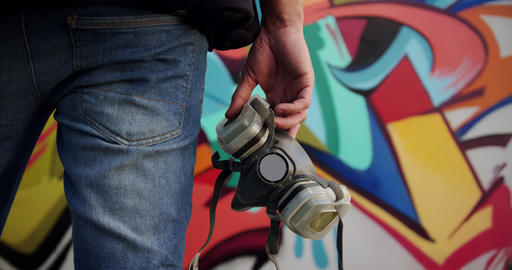 Graffiti artist holding protective mask 4k Footage