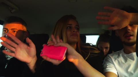 Funny friends dance and sing like crazy in big car driving to vacation. Cyprus Footage