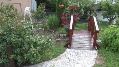 Small bridge in the backyard of a small fountain Footage